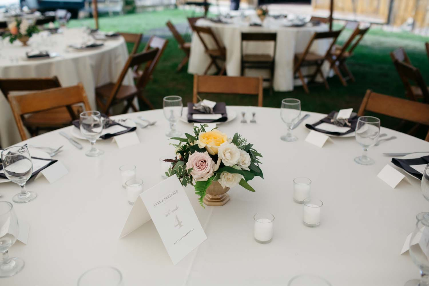 misty farm tent reception flowers