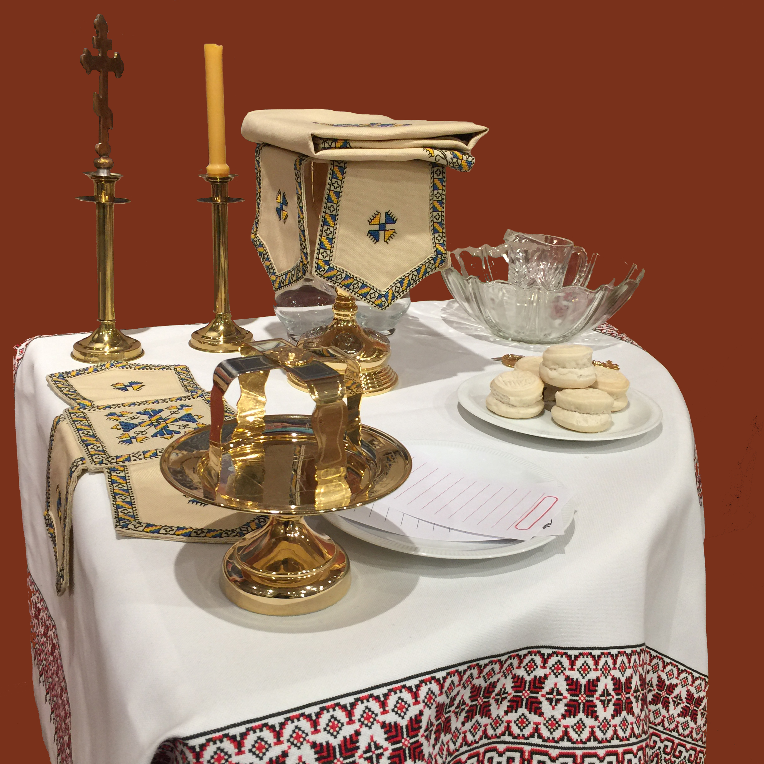 Table of Oblation Жертівник - The Table of Oblation stands on the left side of the altar and is where the bread and wine are prepared for communion during the Divine Liturgy.