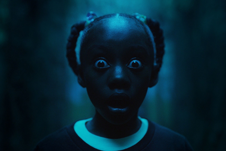 """""""Just like Get Out, Us is a perfect storm of horror, acting, and social commentary; a beautiful dark mirror that conveys a confidence seldom seen in sophomore efforts."""" -"""