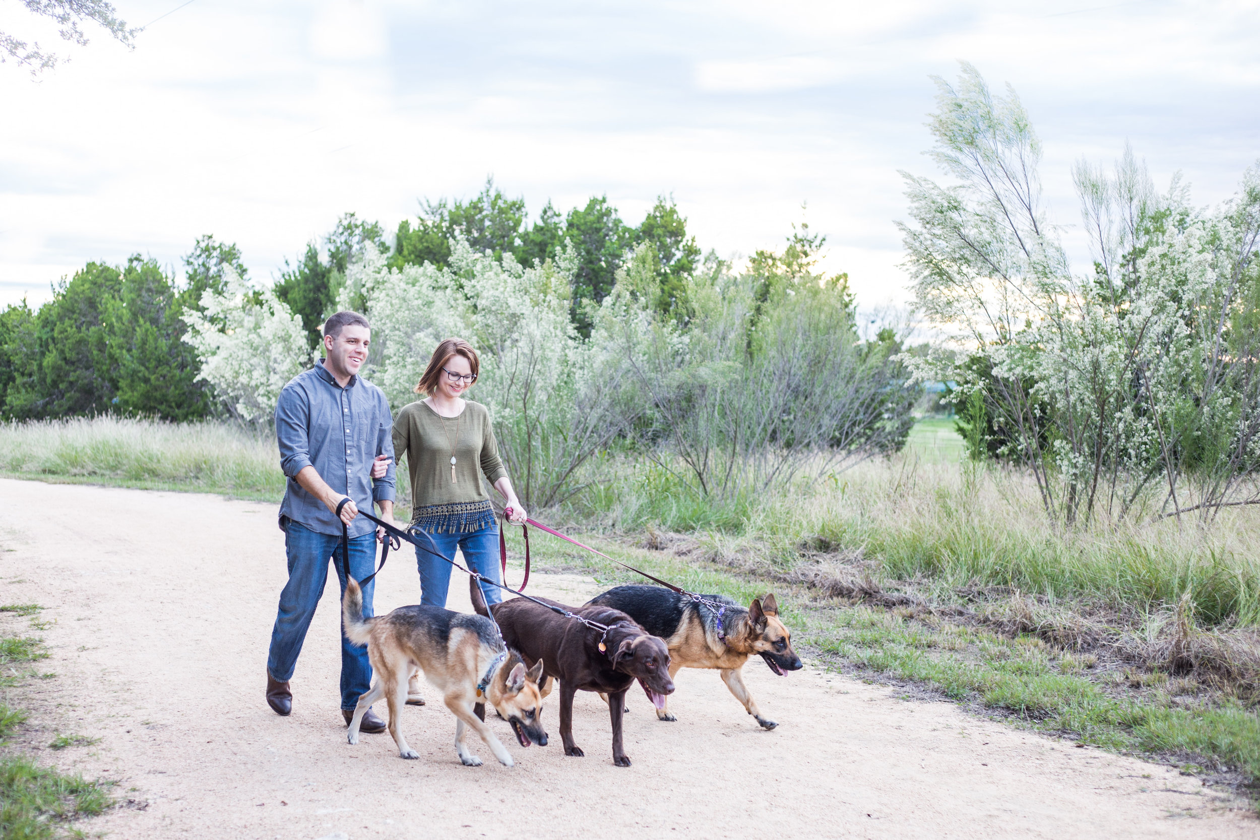 "Me with my husband, Randy, and our ""woof pack"": Linus, Lucy & Violet.  Photo by Coneby Photography"