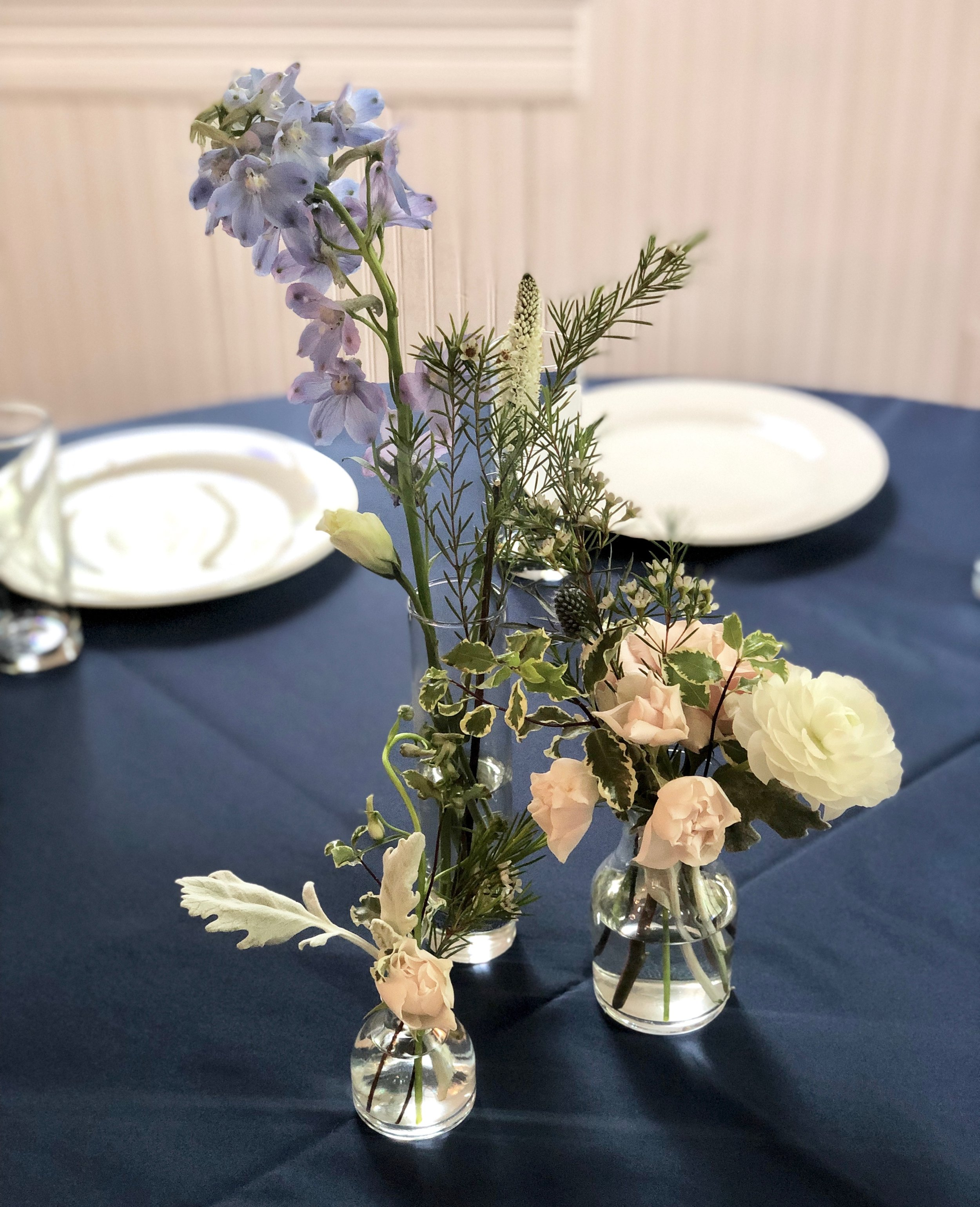 Blue Delphinium in a trio of bud vases
