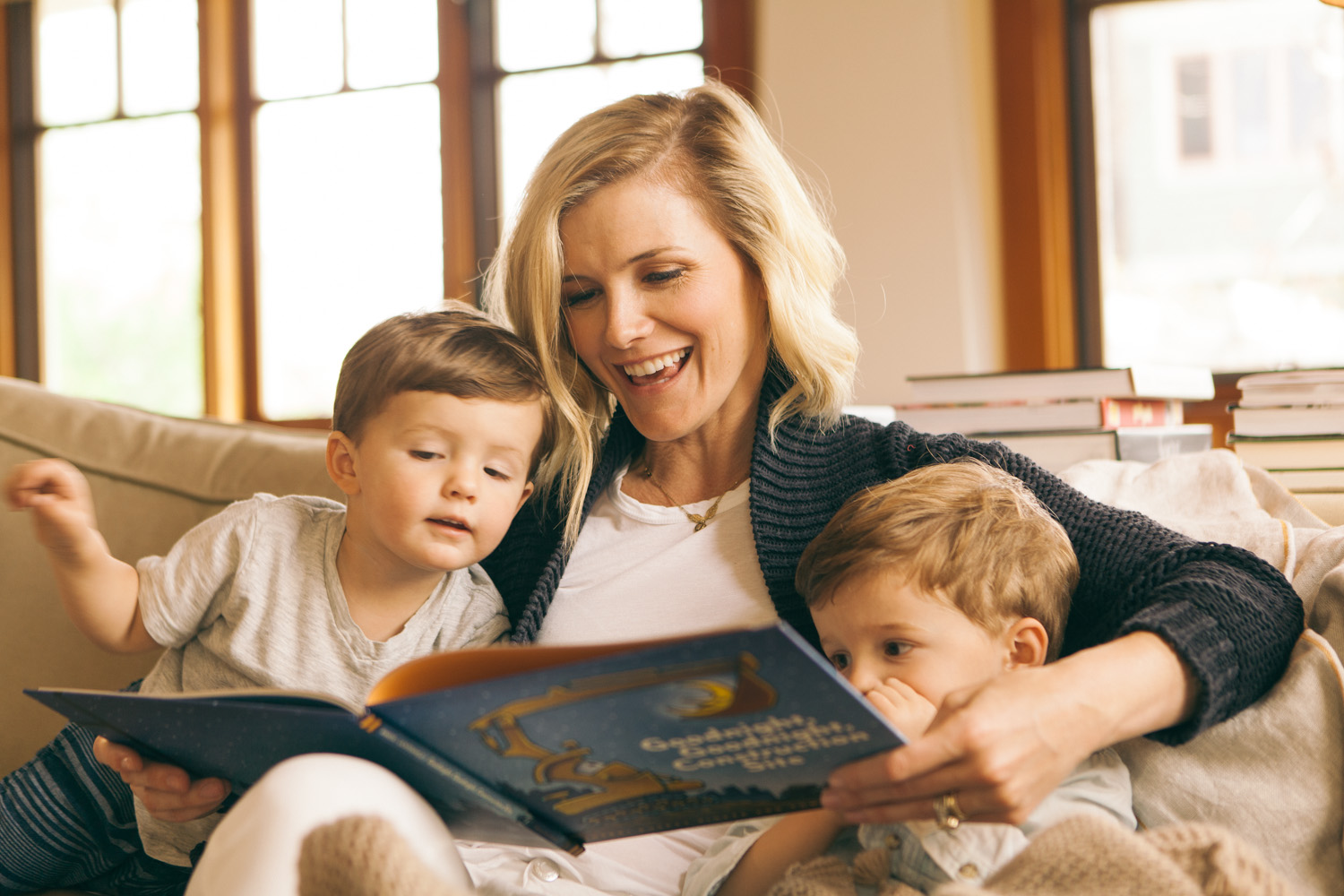 Mom reading a book to two sons (Allison Oswald)