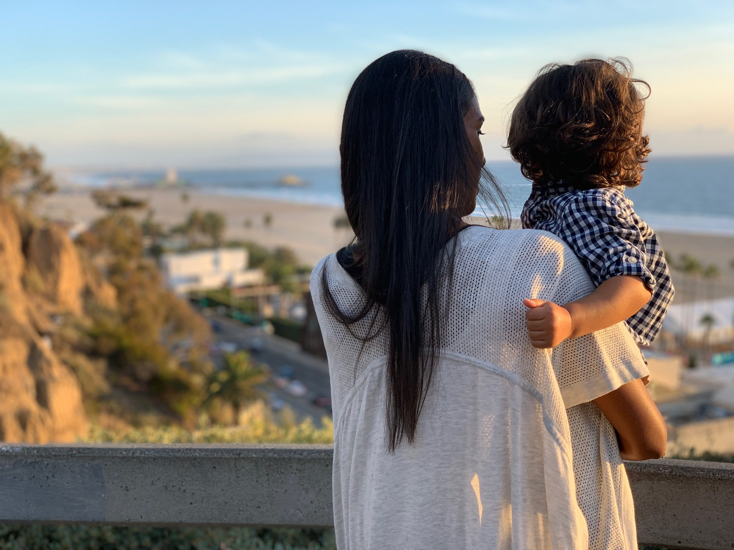 Woman holding baby and looking out at view