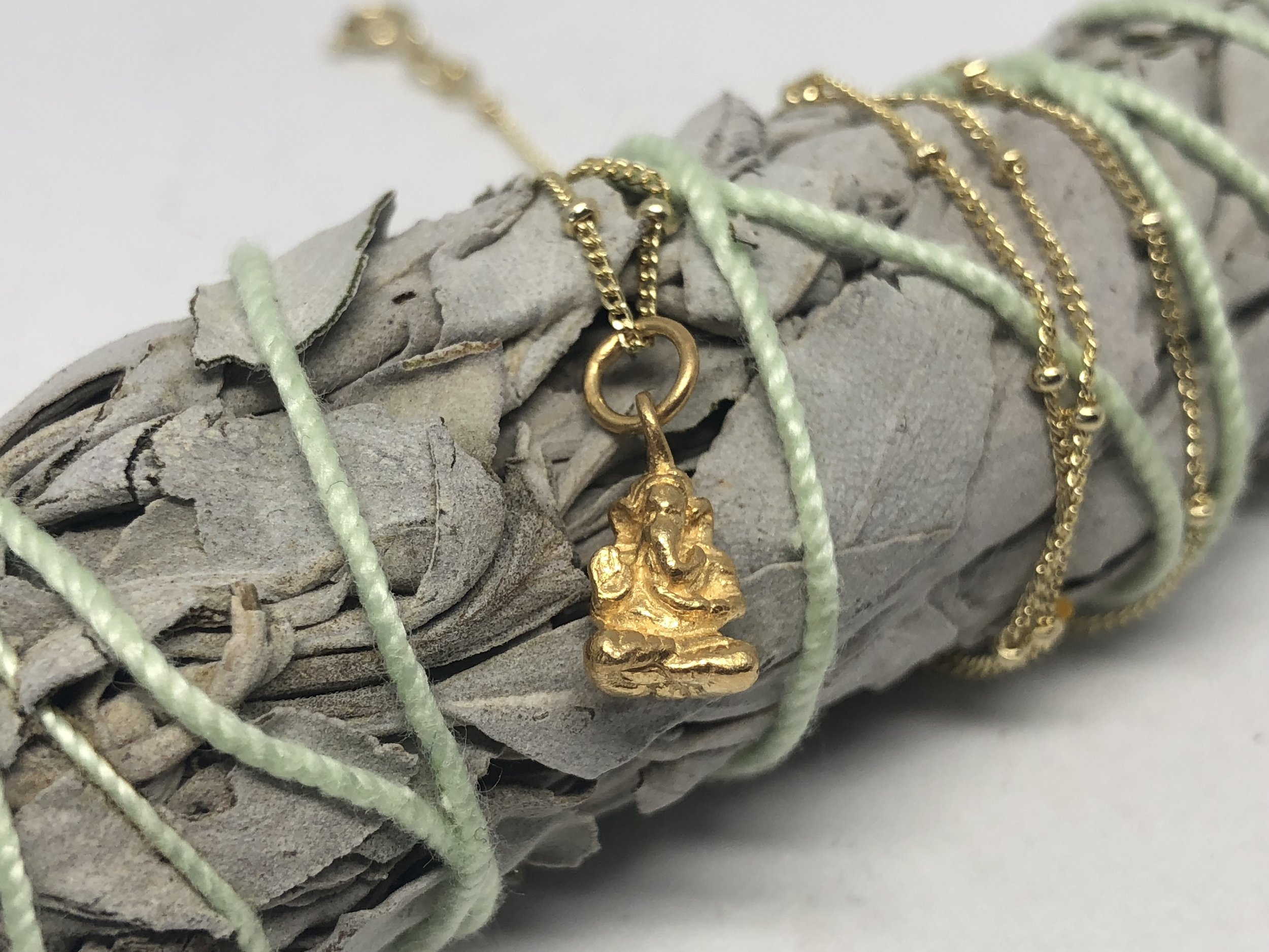 Mini Ganesha - Mini Ganesha necklace made of sterling silver gold plated with gold plated necklace. Click on image to shop