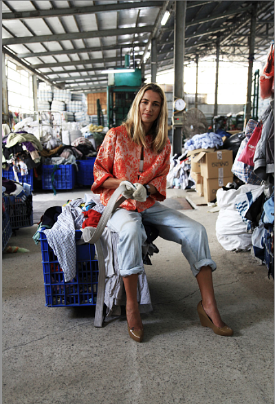 Christina Dean at a secondhand clothing warehouse. Photo: Luke Casey.