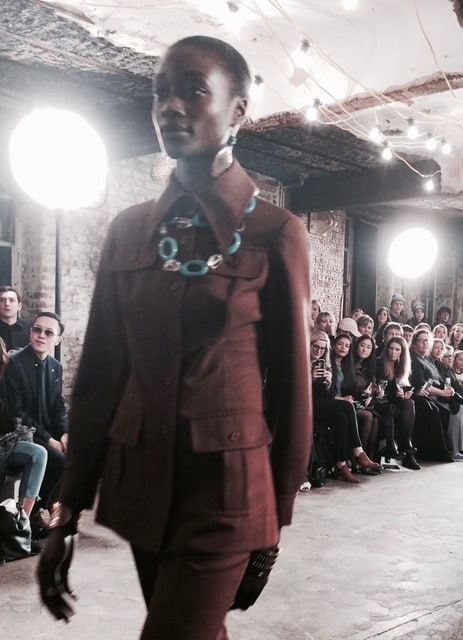 Long collared brown suiting is set off by blue accessories. Picture: Bel Jacobs.