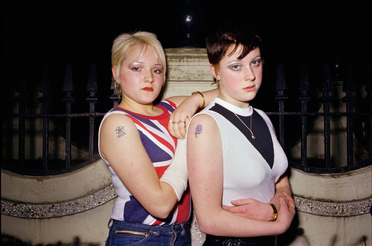 Carrie-Kirkpatrick-left-and-Gill-Soper-outside-the-toilets-in-Crystal-Palace-London-in-November-1980.jpeg