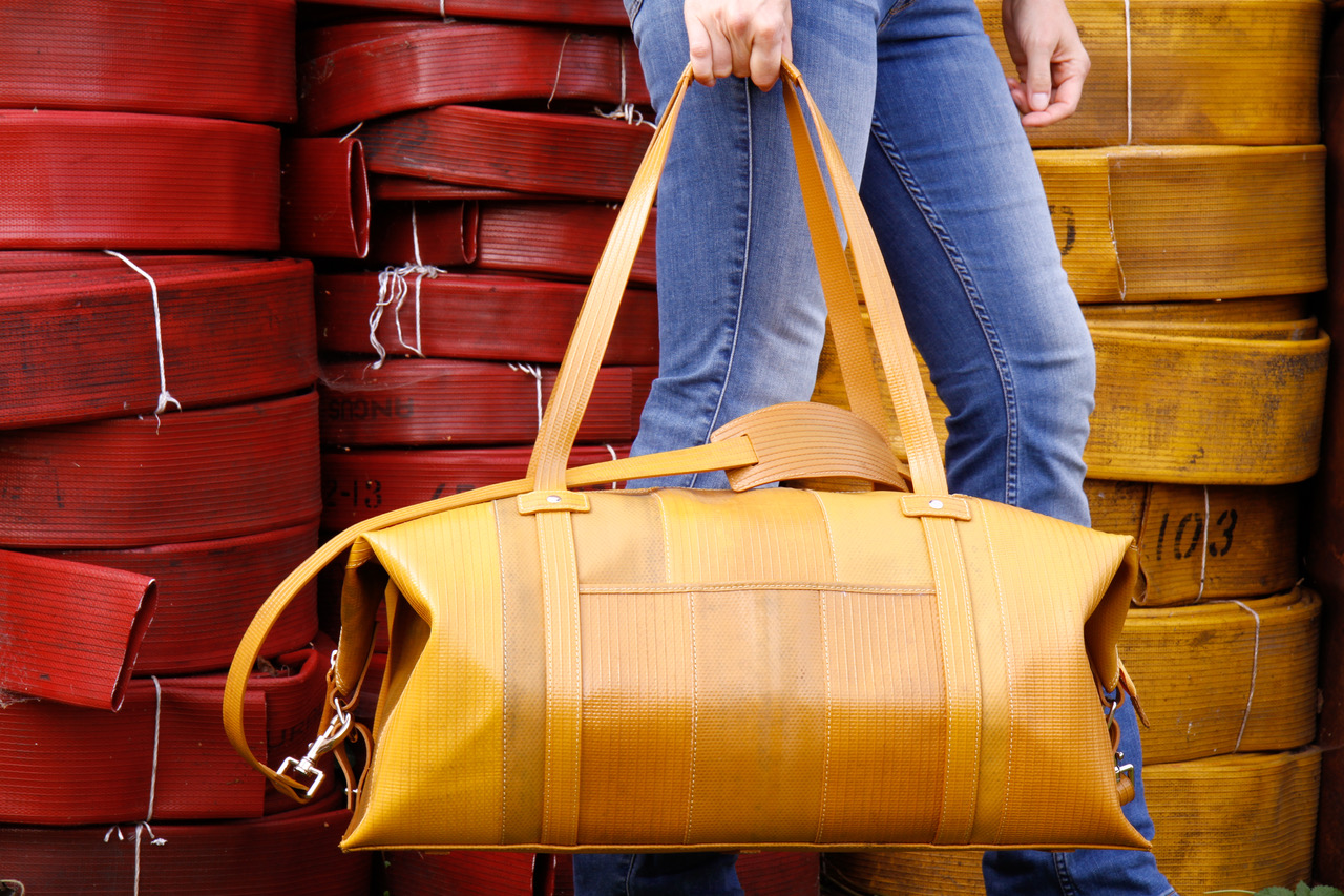 Elvis & Kresse's weekend bag looks proud of its origins as decommissioned firehose. Picture: Elvis & Kresse.