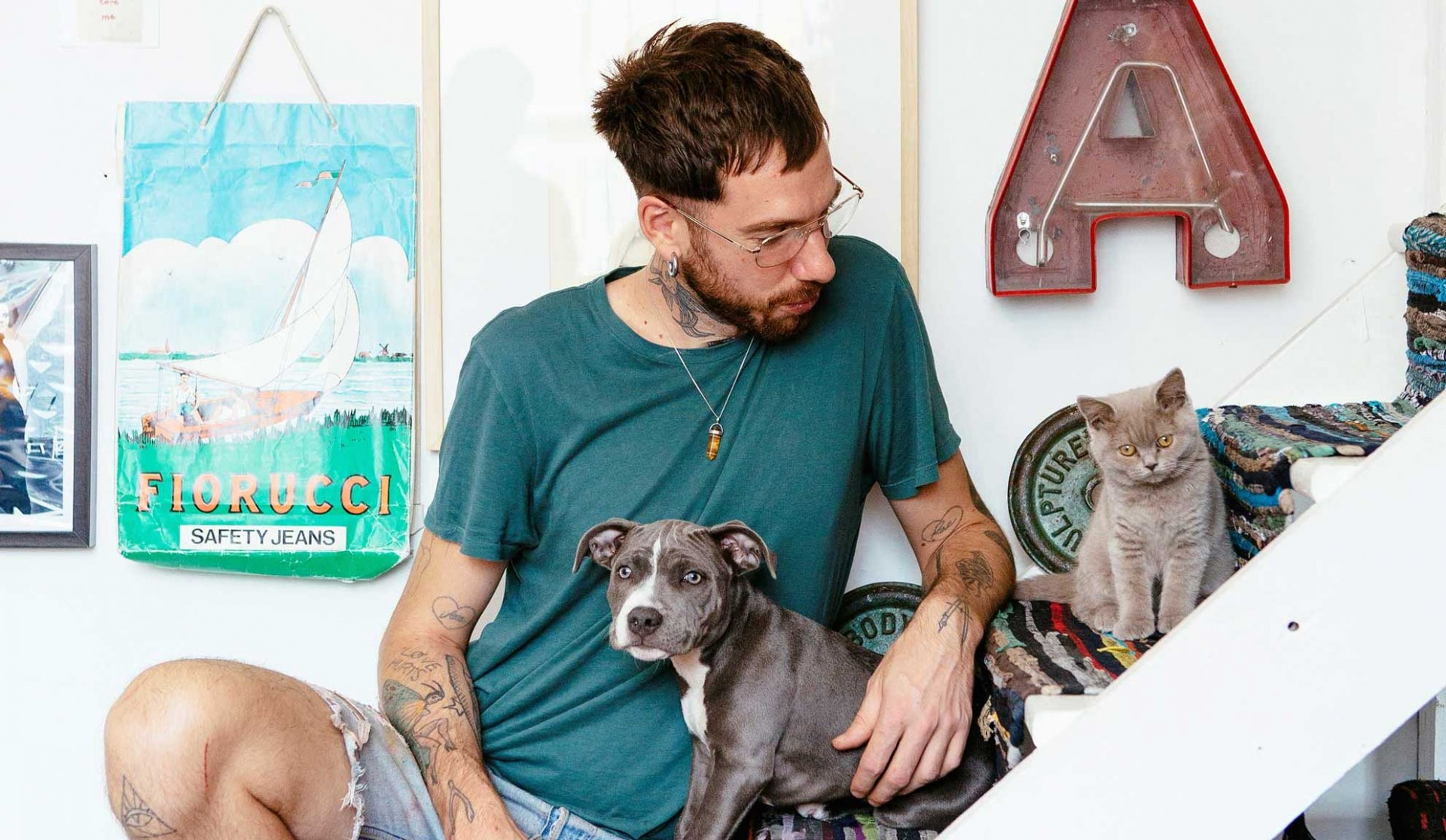 Alex Noble at home with Ash the dog and kitten Spuki Joi. Photo: Anna Batchelor for annaandtam.com