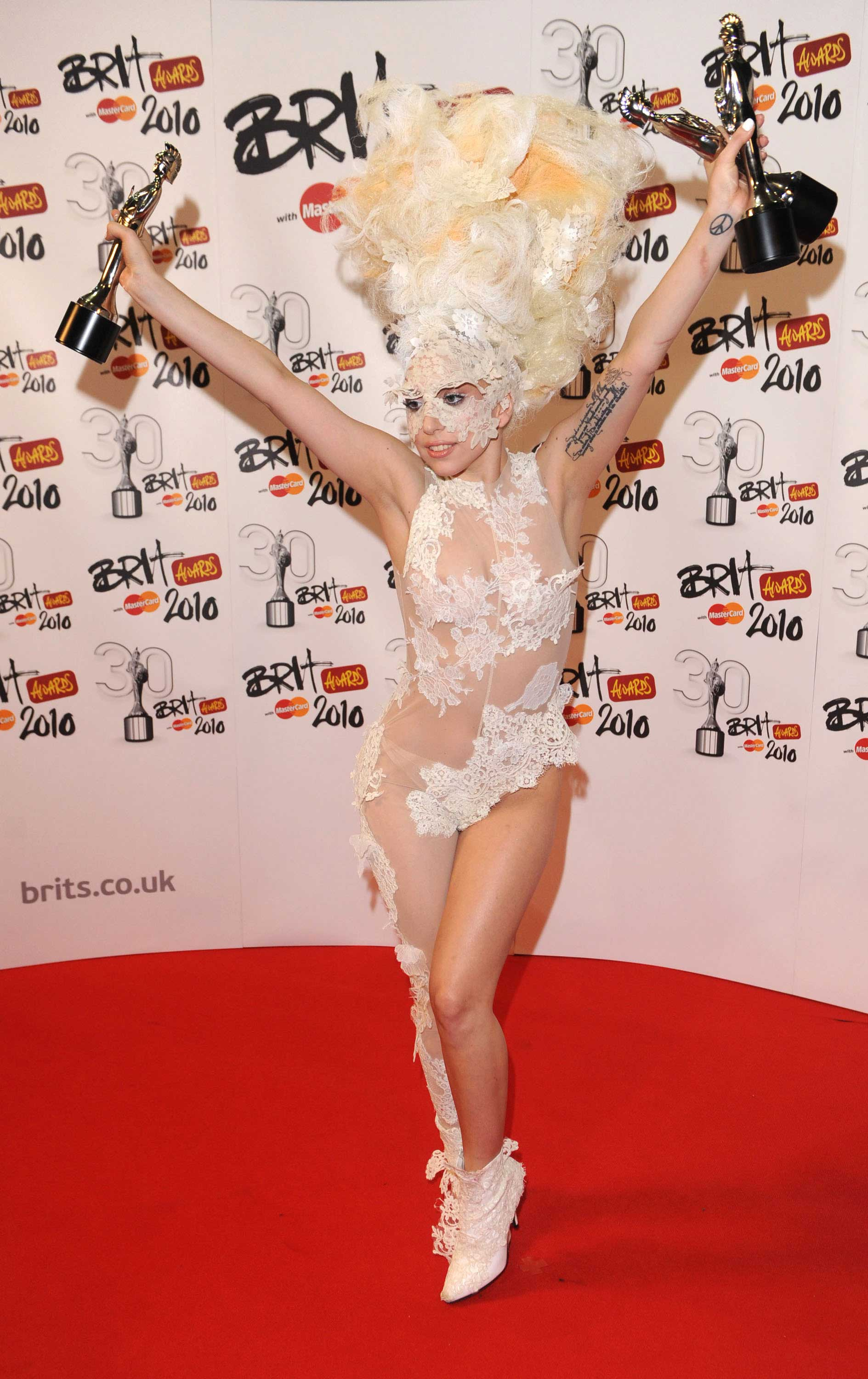 Lady Gaga wears Alex's lace body suit, shoes and veiling cloak at the Brit Awards 2010.