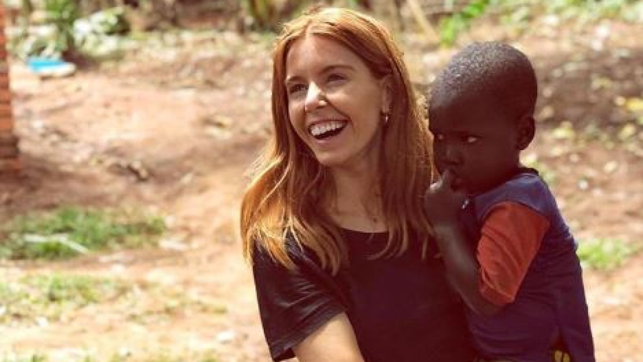 Stacey Dooley posted an image of herself in Africa on Instagram, holding a small child.