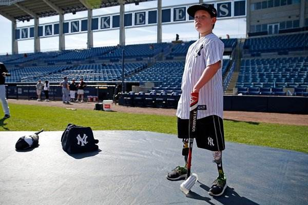 Landis Sims Was Born Without Lower Legs and Hands. That's Not About to Stop Him. - The 10-year-old signed a one-day contract with the Yankees in 2016. One day it might be longer than that.