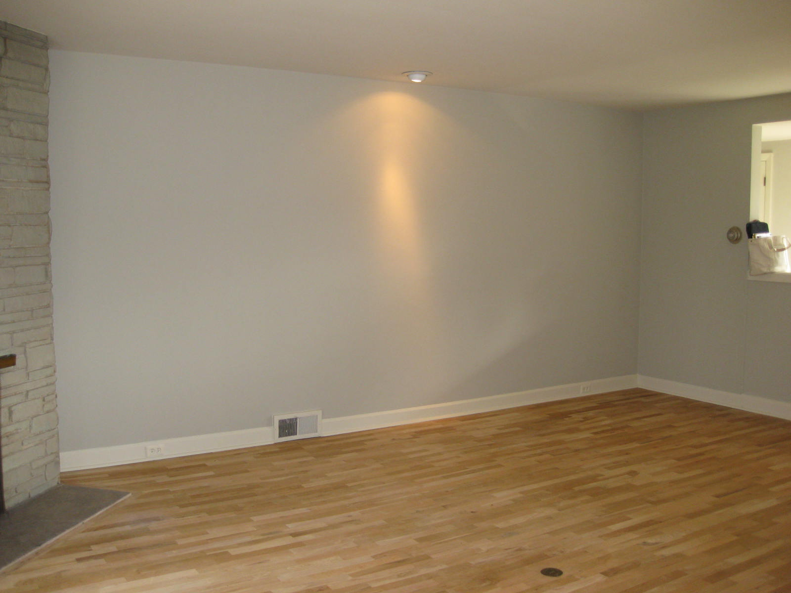 This blank wall becomes the 'slat wall' and possibly holds the television?