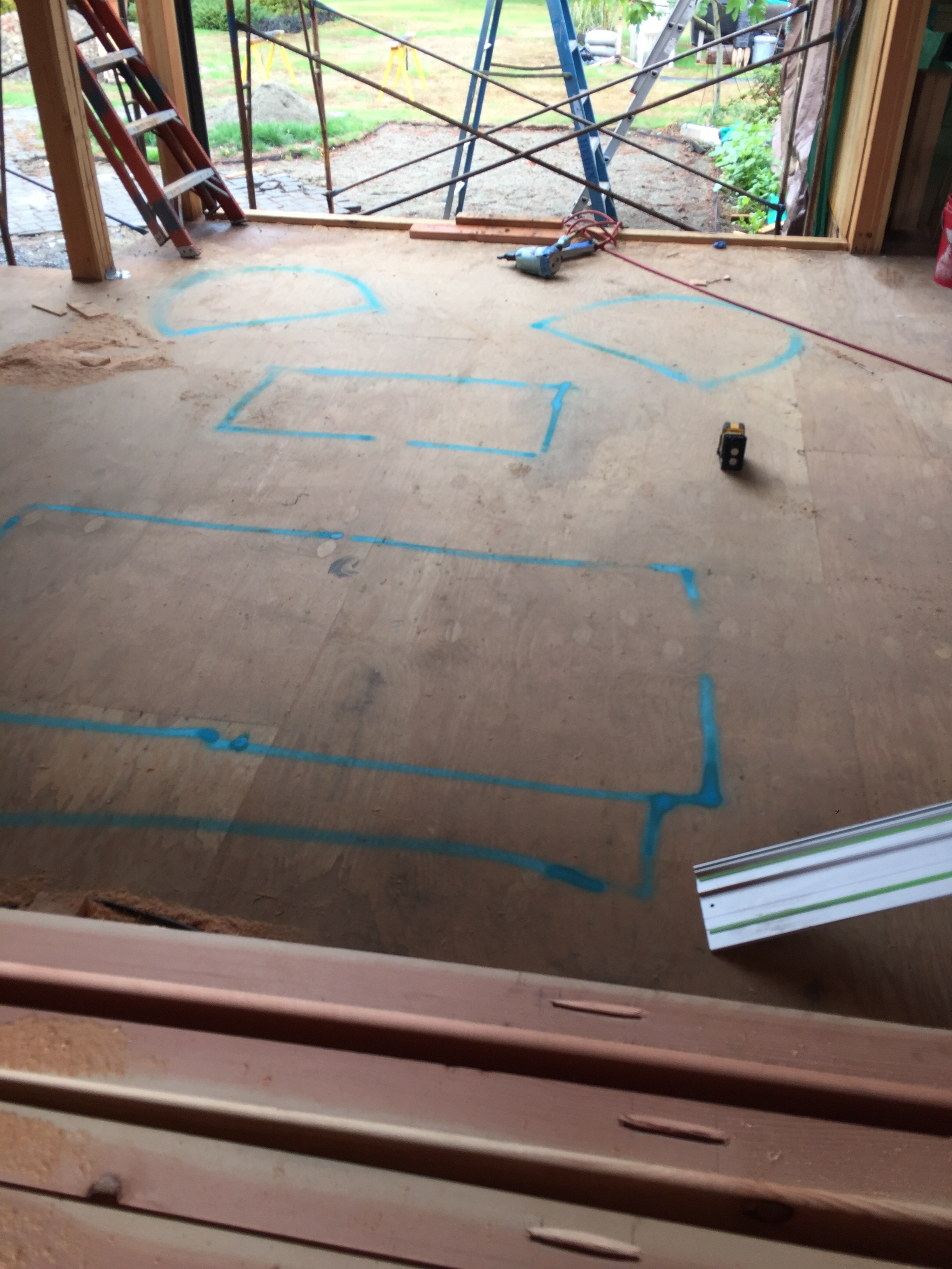 In order to see where the new chandelier will hang in the living room, I used spray chalk to mark out where all of the furniture will live.