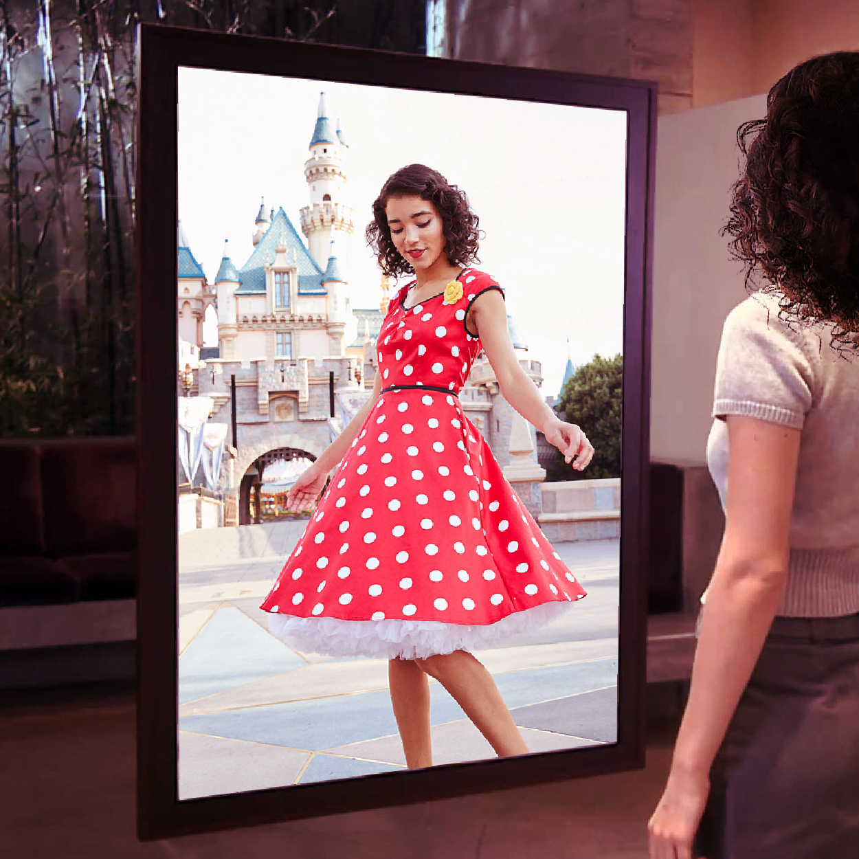 Virtual fitting rooms - Shoppers can try on clothes and outfits in a virtual environment with live Disney-themed background videos.