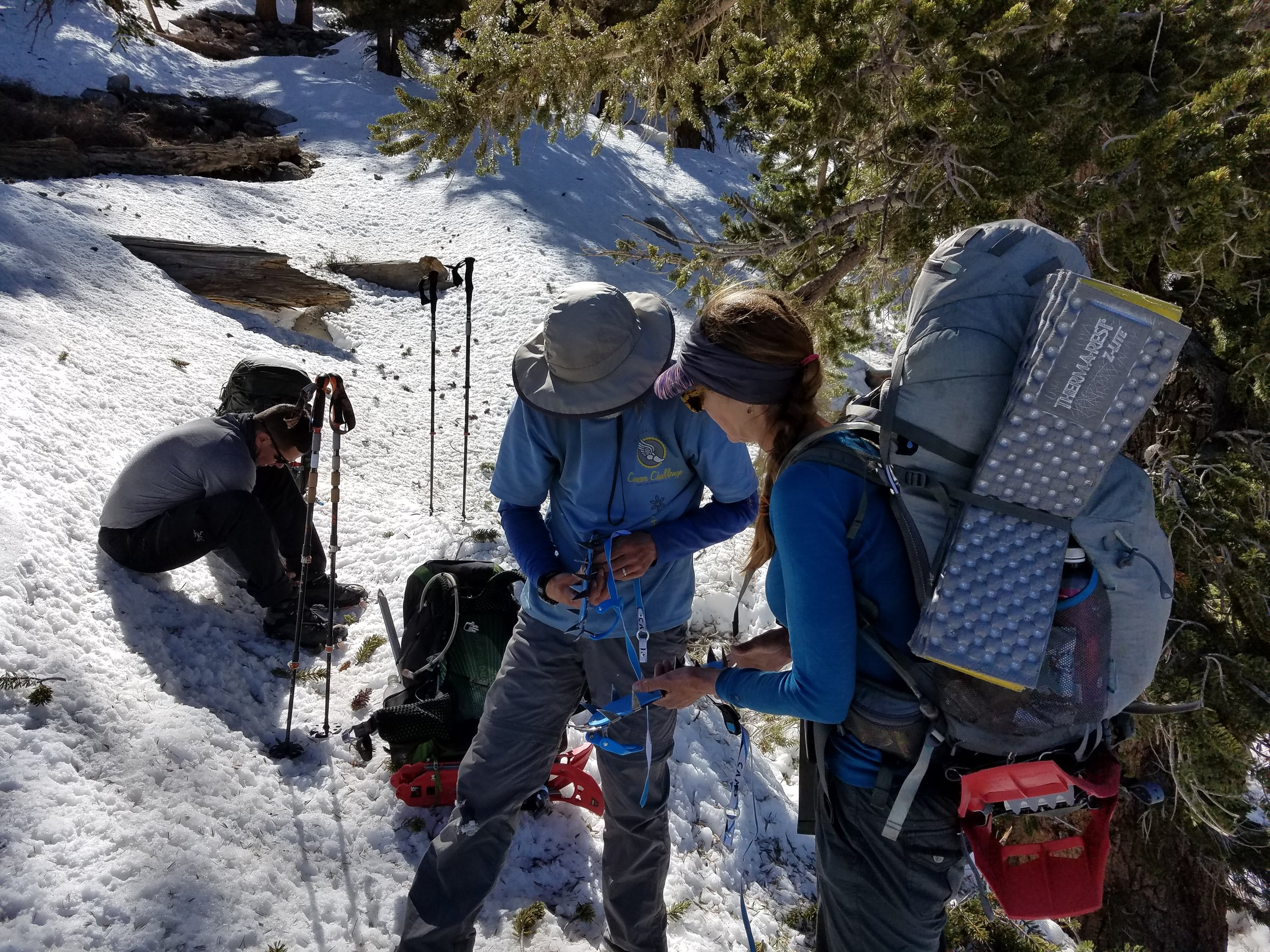 Everyone figuring out how to strap on their crampons.