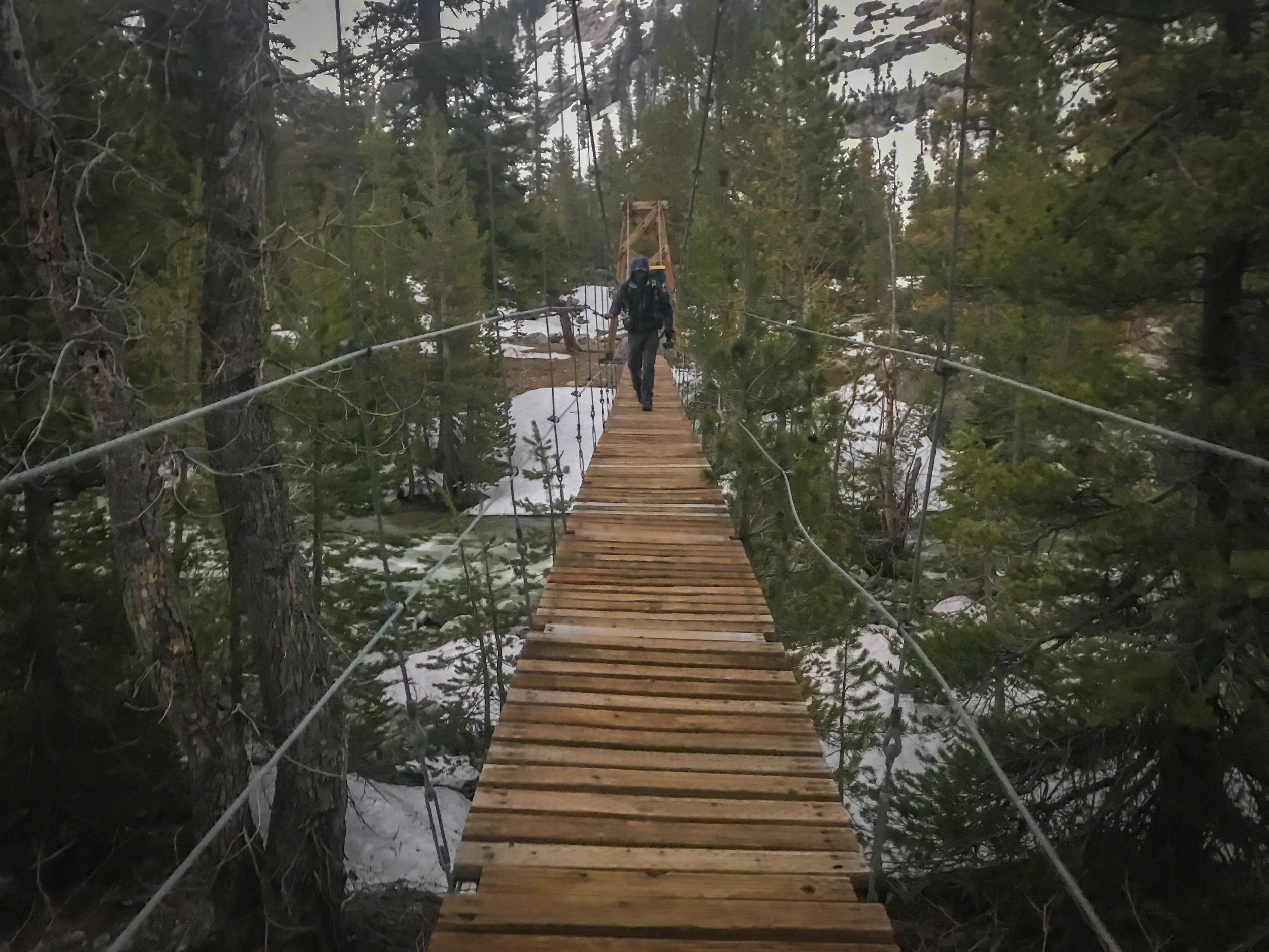 "Crossing the ""washed out"" Woods Creek suspension bridge, which was in surprisingly good shape for a completely demolished bridge..."