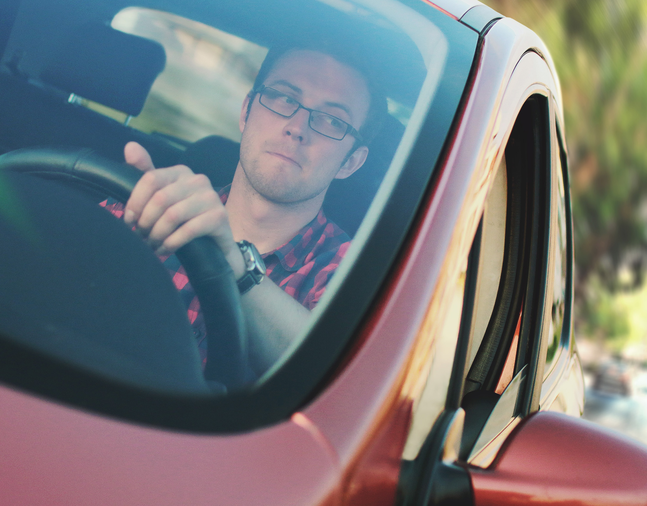 man in car for Personal Defense Connection's Am I Being Followed post