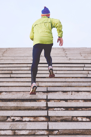 man running up stairs for Personal Defense Connection's get a grip post