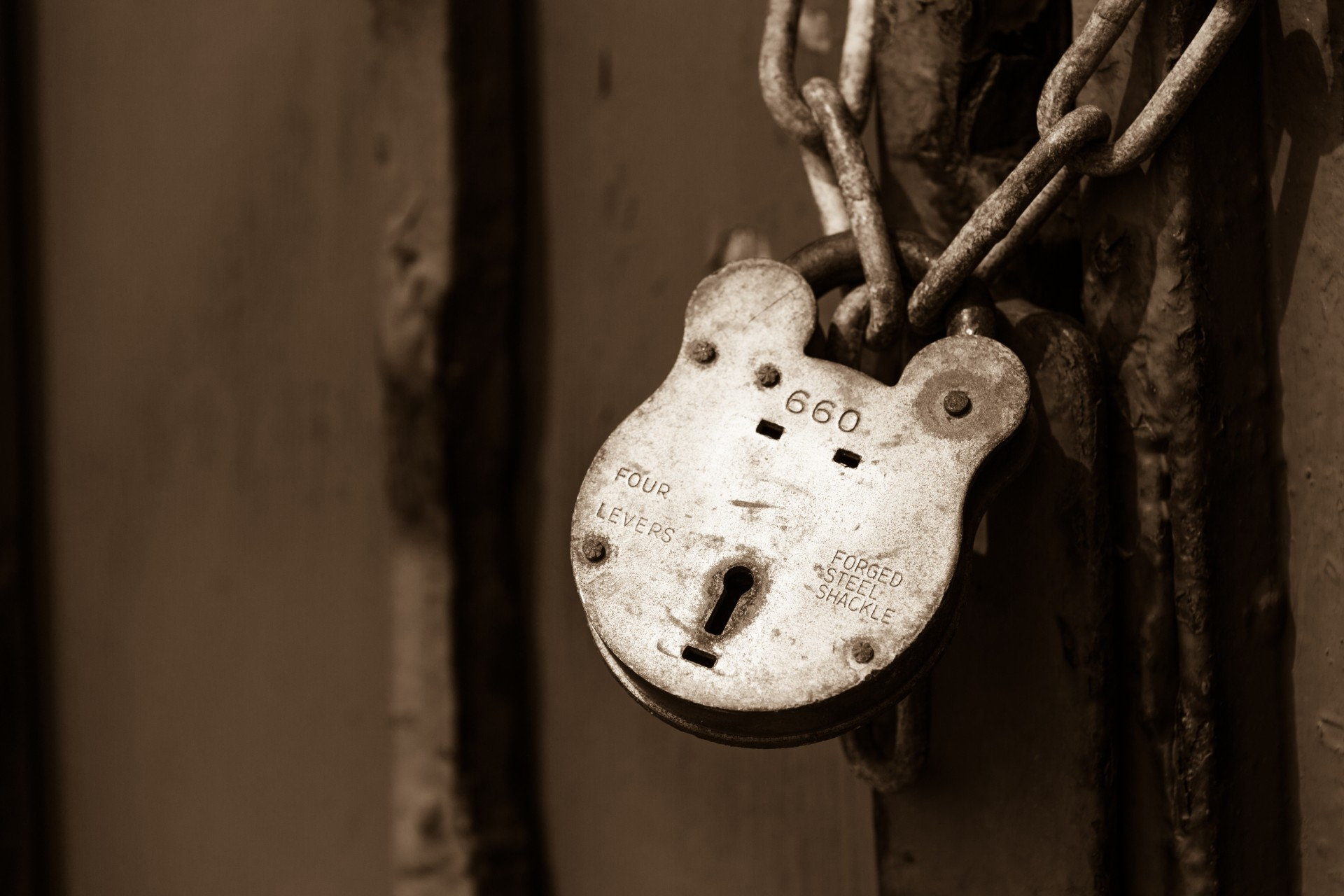 Picture of a lock and chain to protect a home