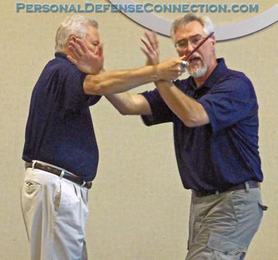 Dave doing a self defense demonstration at Baker College.