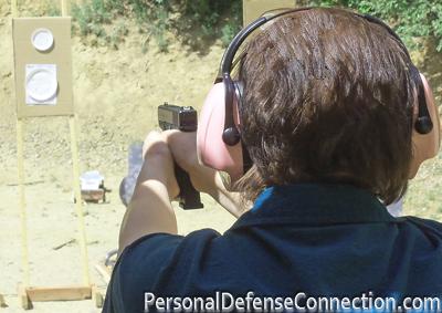 Practicing on the Gun Range. Firearm Classes.