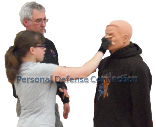 Teaching a self defense class member the eye gouge.