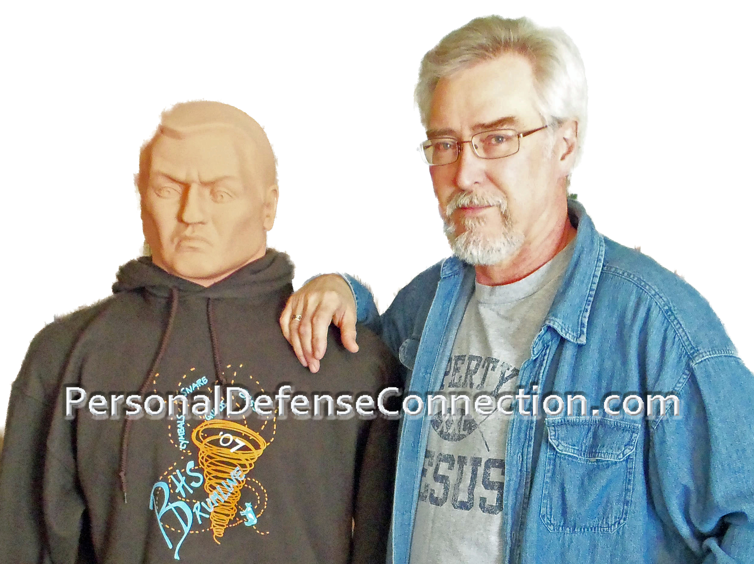 Owner and Instructor, Dave, posing with his Self Defense Class assistant, TED.