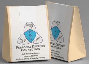 Two Gift Bags with the Personal Defense Connection logo on them to put Gift Cards in.