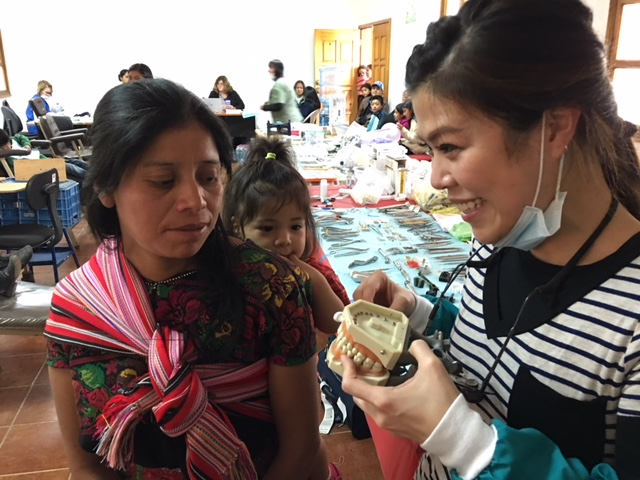 Livvy, Hygienist, on the 2017 mission trip-teaching home care.