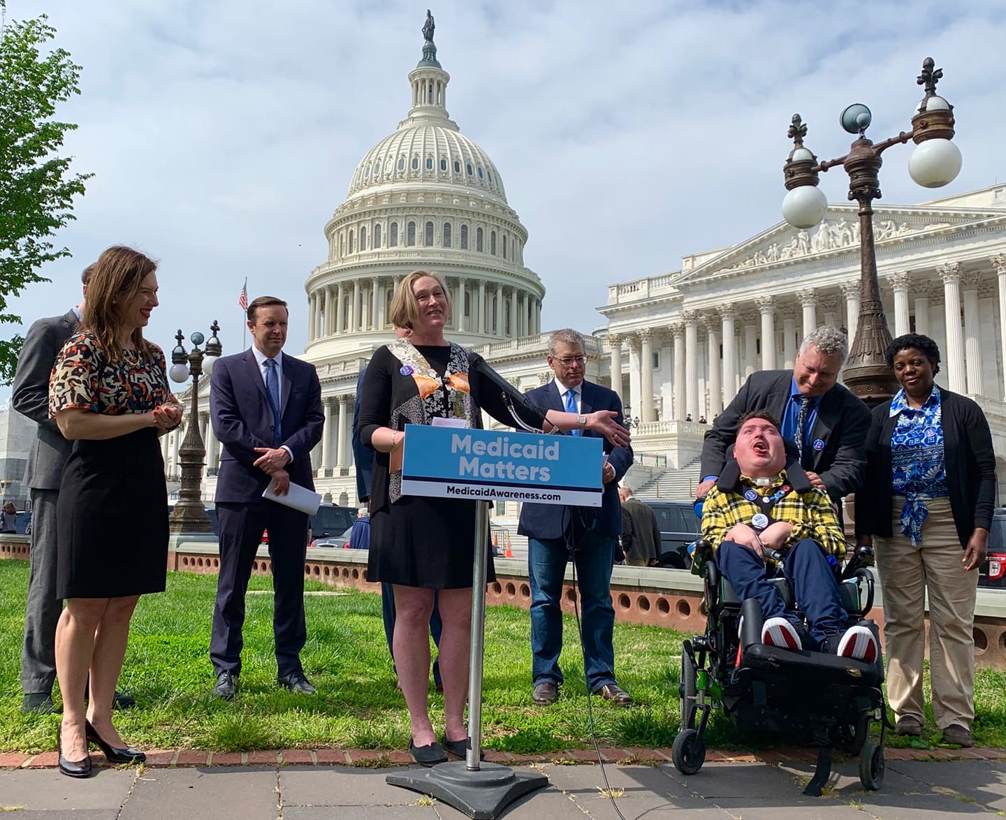 Jeneva with her son Robert and husband Roger advocating for Medicaid in front of the Capitol with members of Congress and Little Lobbyists mom Laura.