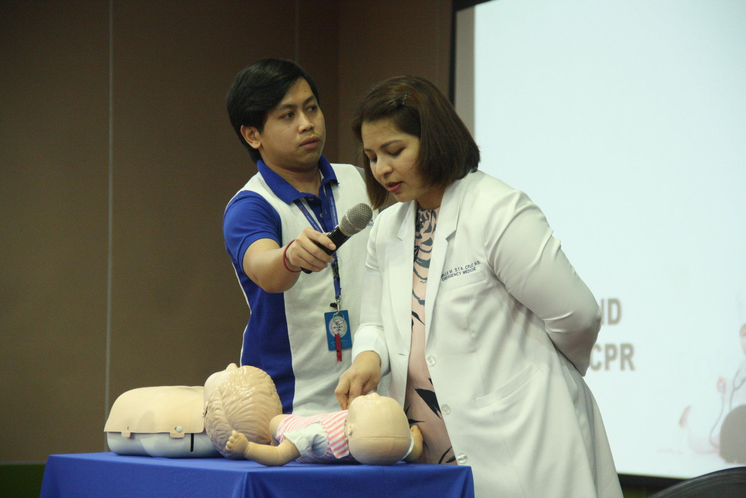 Dr. Camille Sta. Cruz, Emergency Medicine Doctor, demonstrating proper first aid for babies