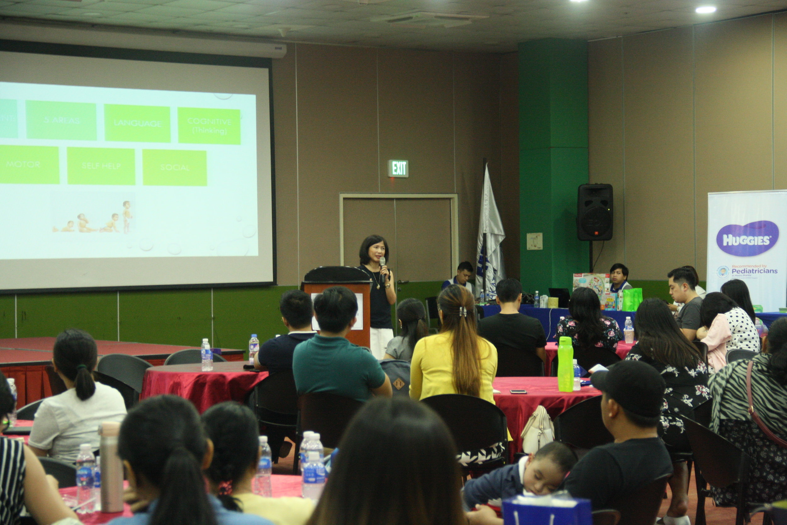 Dr. Maria Michiko Caruncho, MakatiMed's Developmental Pediatrician, educating attendees on the red flags to watch out for in child's development