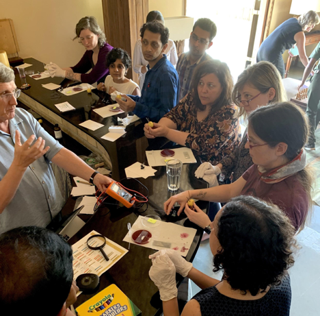 Each lecture was accompanied by a number of hands-on activities to viscerally understand the chemistry concepts discussed. Pictured here is a dye-sensitized solar cell experiment.