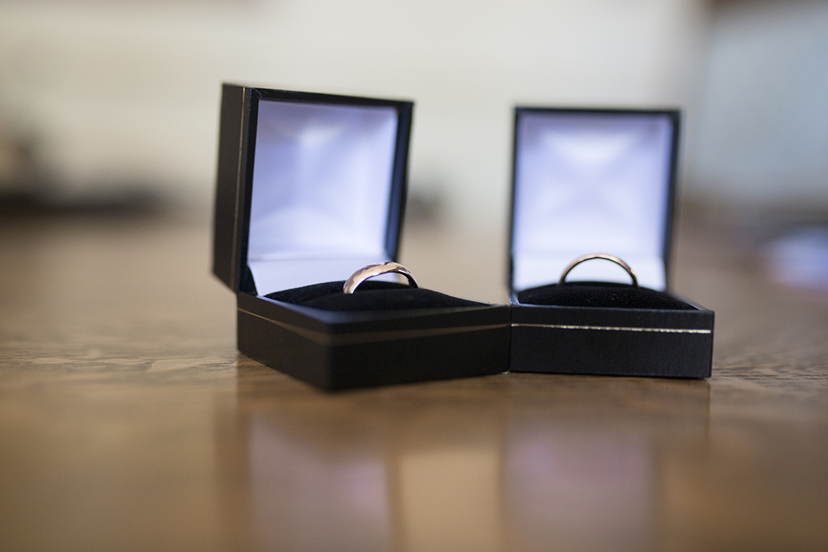 wedding rings in their boxes Sophie Lake Photography