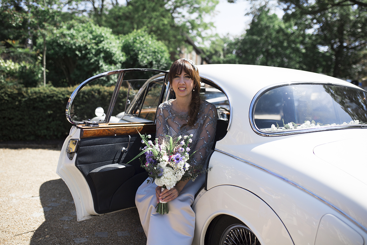 Bride in wedding car Sophie Lake Photography