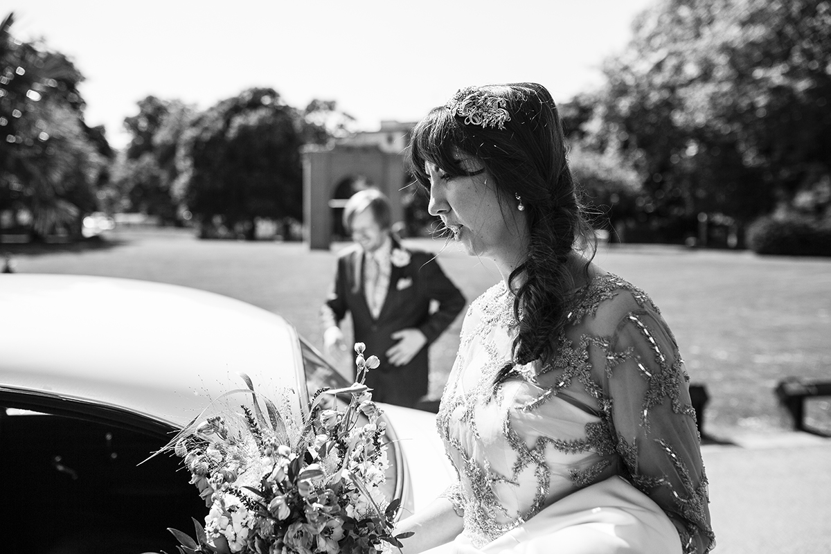 Bride getting into car Sophie Lake Photography