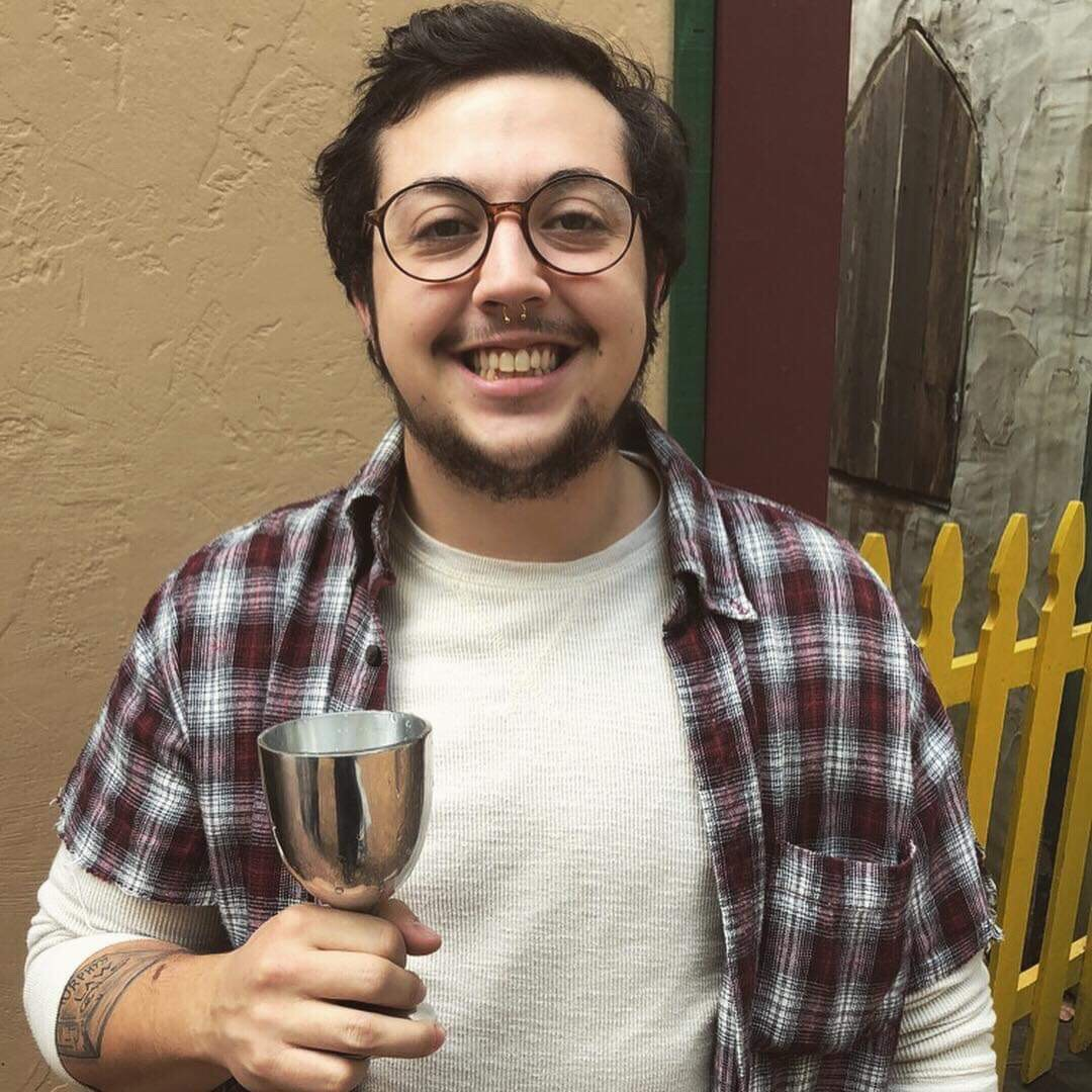"""Kristopher Fletcher - """"I'm 24 and I live in Allen Park., Michigan. I am a trans male and I started my transition about 3 and a half years ago. I used he/him pronouns. I live with my awesome girlfriend and spend most days managing the brewery I work at. When I'm not there I like to do incredibly nerdy things such as tabletop RPGs, video games, and reading comics. My passion is making anything, whether it be out of wood, leather, or metal I just like transforming it into something useful. I decided to be a part of this film because it is a raw and open testament to what we go through as trans individuals. It shows the ups and the downs of our lives and gives the world a glimpse into our community."""""""