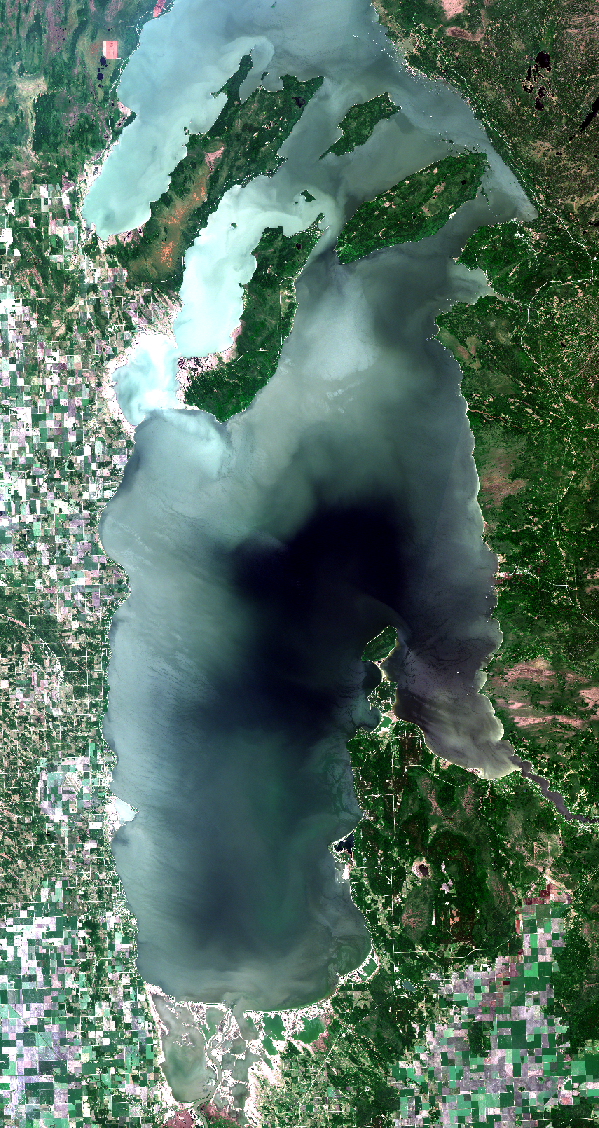 June 20, 2018. Cloud free images are brighter in appearance than those with some cloud present. Clouds increase the range of data values in satellite images which decreases contrast for land and water features. Comparisons of color among images over time require standardization not applied here. Visual comparisons within a single image are meaningful. Click    here    for high resolution satellite image.