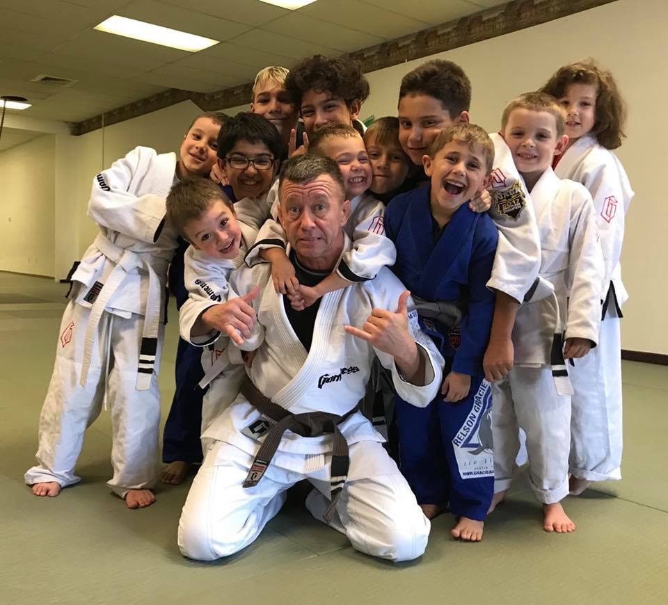 The Saturday youth class poses for a fun photo, featuring Ryan & John with their new degrees.