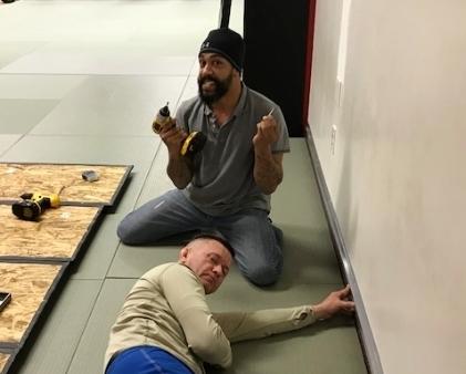 Steve and Coach Daniel install the rails