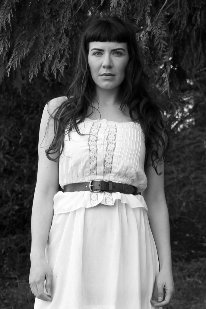 Amanda Walker Storey - Amanda works by day as a director of new business development. She is a Mom, beauty blogger, vintage clothing seller, photo stylist and model.