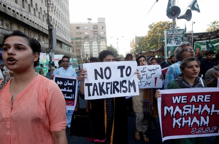 Demonstrators hold signs and chant slogans condemning the killing of Mashal Khan, student of Abdul Wali Khan University after he was accused of blasphemy, during a protest in Karachi, Pakistan. Image: Akhtar Soomro/Reuters