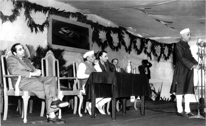Nehru speaking at the foundation stone–laying ceremony of the Tata Institute of Fundamental Research, Bombay, on 1 January 1954. Seated (L-R) - Homi Bhabha, Morarji Desai (then Chief Minister of Bombay), J. R. D. Tata, and Shanti Swarup Bhatnagar. Photo:    Nehruvian Science and Postcolonial India
