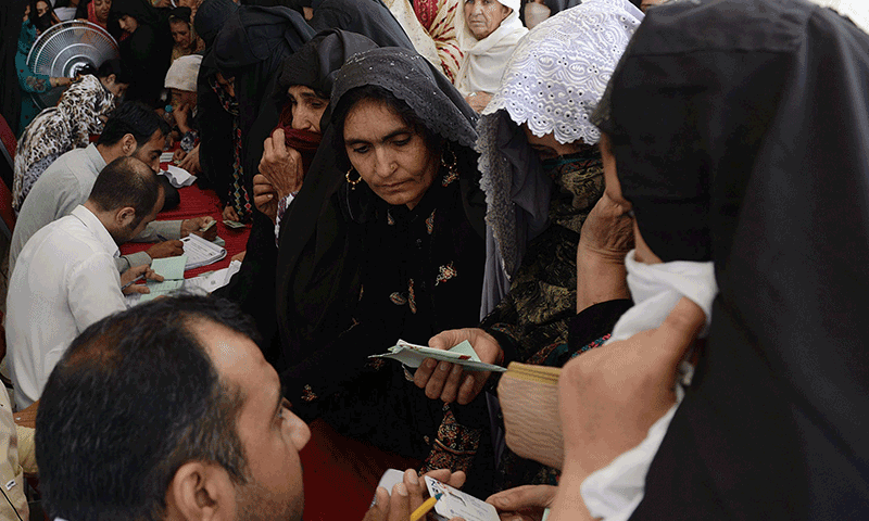 Internally displaced persons (IDPs) from North Waziristan registering themselves in a camp. In 2014, the number of IDPs was estimated to be over 800,000. Image:    Dawn