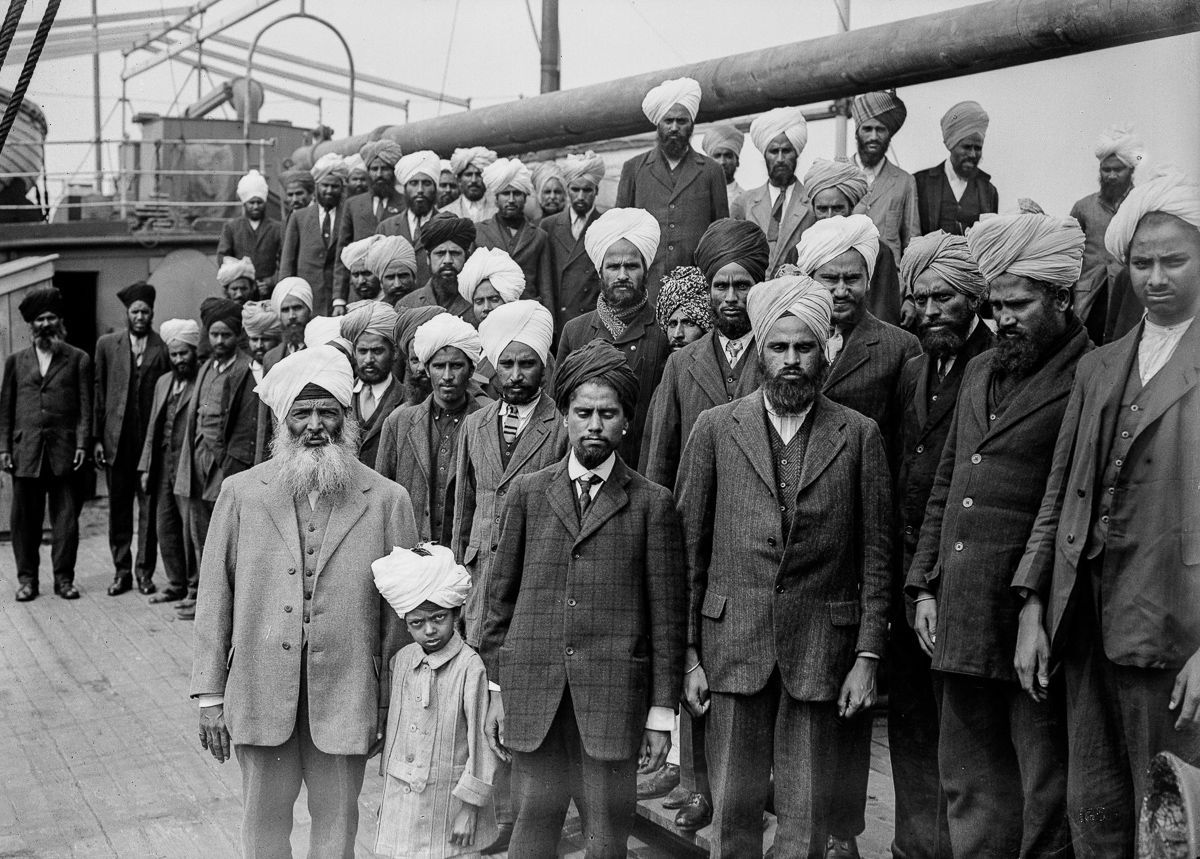 Passengers on-board Komagata Maru. Organizer Gurdit Singh Sandhu (front left) and other passengers pose for a photo. Gurdit Singh was a supporter of Ghadar Party and was the prime organizer of this expedition. Image: Leonard Frank/Vancouver Public Library