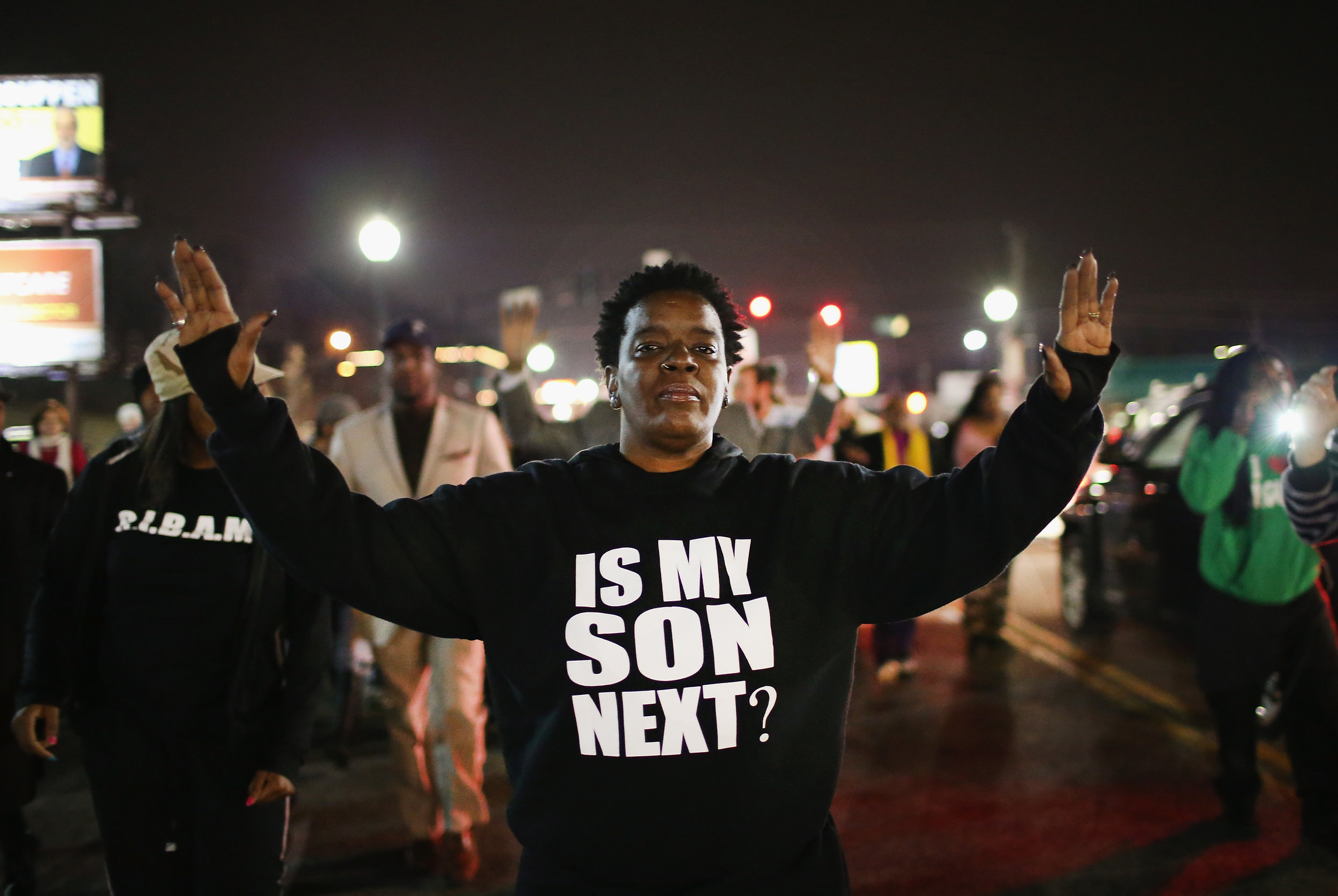 "A protester at the Black Lives Matter Ferguson protest in 2015 asking if ""their son is next"", referring to the history of police violence towards black people in the US. Country wide demonstrations took place after 18-year old Michael Brown was shot and killed by police officer Darren Wilson on August 9, 2014. Image:    Popular Resistance   ."