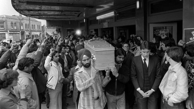 April 1979: People raise their fists as they see Blair Peach's coffin carried at his funeral. Image:    BBC