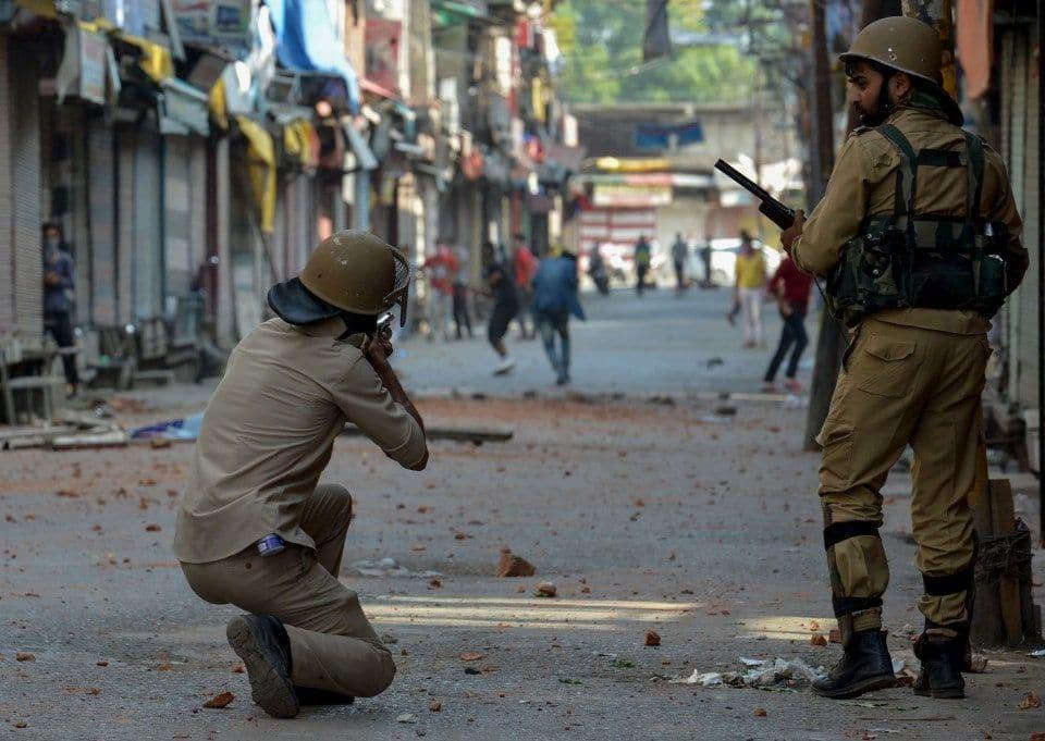 Jul 2016, Srinagar: Indian police use pellet guns against Kashmiris protesting the killing of Burhan Wani, a 22 year old militant separatist leader. Image:    Washington Post