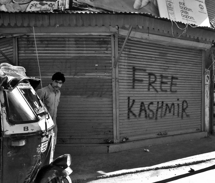 """'Free Kashmir"""" graffiti on the door of a shop, a common sight in Jammu and Kashmir. Image:    News Click"""